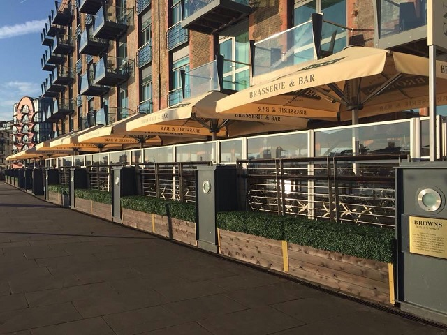 Browns Butlers Wharf Summer Party SE1. Exterior of venue. With umbrellas, tabkes and chairs for guests to enjoy view and enjoy event.