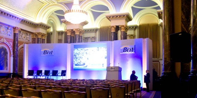 Gibson Hall Venue Hire EC2, theatre style seating with large screen perfect for presentations, company theming