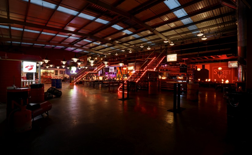 open plan view with neon lights of the Other Room Hawker House Venue Hire SE16