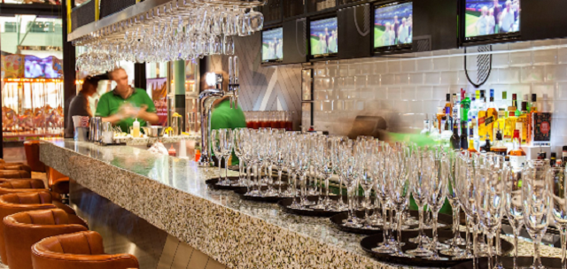 View of the bar with champagne glasses Hotel Football Manchester Christmas Party M16
