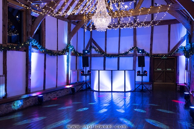 Loseley Guildford Park Christmas party GU3. Dancing area in barn with dj booth and lights.