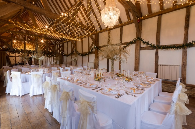 Loseley Guildford Park Christmas party GU3. Barn decorated for a christmas dinner.