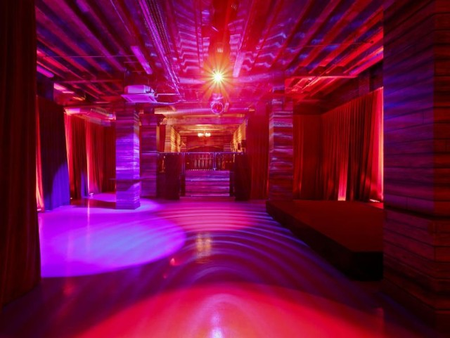 View of the The Lodge decor with red mood lighting Victoria House Christmas Party London WC1
