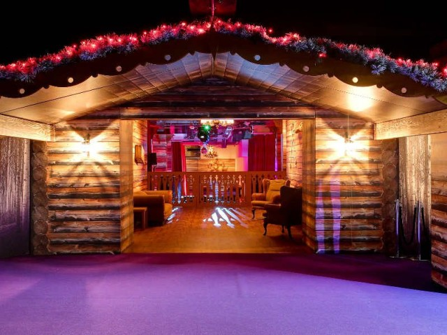 View of a log cabin with Christmas light decor The Lodge Victoria House Christmas Party London WC1