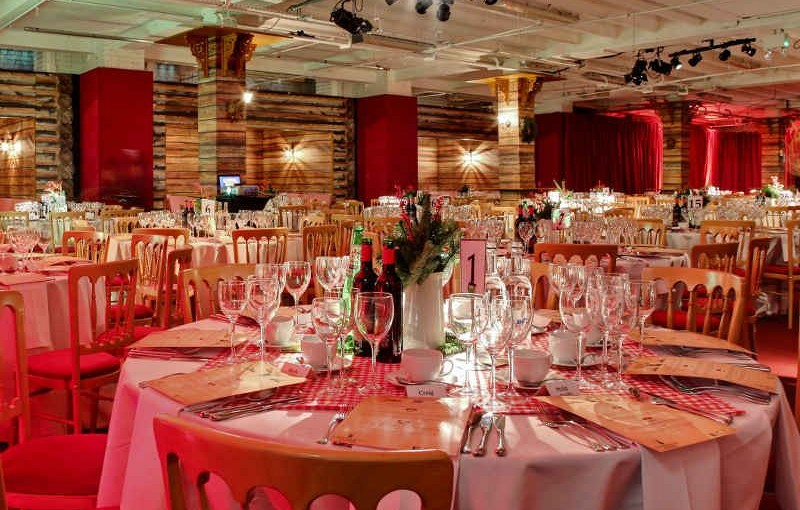 Round tables dressed for dinner with ski lodge decor The Lodge Victoria House Christmas Party London WC1
