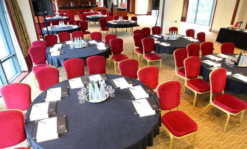 Piccadilly Suite round tables set out in cabaret style for a meeting with natural daylight Macdonald Manchester Hotel Venue Hire M1