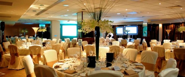 Piccadilly Suite set out for a Christmas party with round tables Macdonald Manchester Hotel Chrismtas Party M1