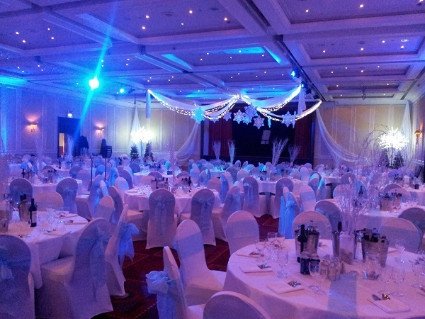 Marriott Hotel Glasgow Christmas Party G3. Large dining area with tables and chairs with festive disco lights
