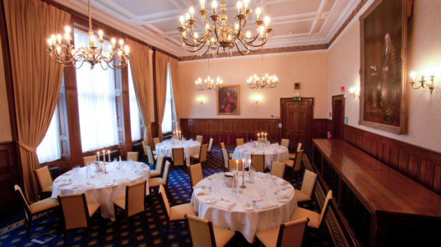 Old Council Chamber and Dining Room round table set up for a dinner with natural daylight Law Society Venue Hire WC2