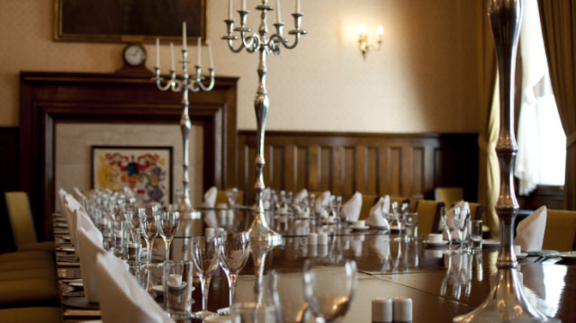Old Council Chamber and Dining Room set up for a private dinner boardroom style with candelabras Law Society Venue Hire WC2