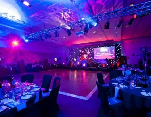 Radisson Blu Hotel Glasgow Christmas Party G2. Seated dinner area with dance floor to the side. With Disco lights on.