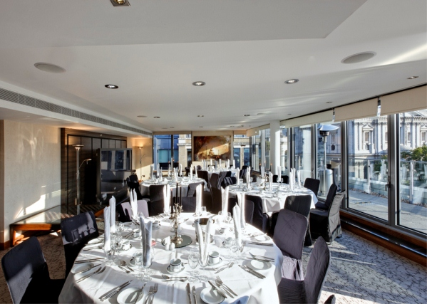 Royal Suite set up for a Christmas Gala dinner with round tables dressed for dinner Grange St. Pauls Hotel Christmas Party EC4