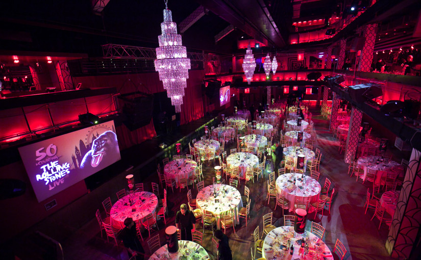 Building Six Venue Hire SE10, round tables set for dinner, chandeliers, balcony