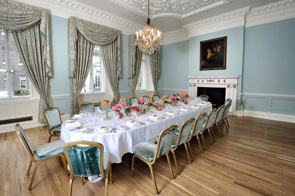 Dartmouth House Venue Hire W1, dining room, banqueting style, centre pieces, fire place, natural daylight