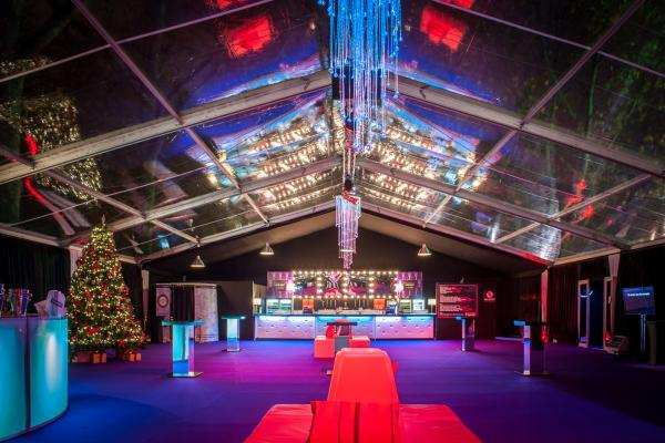 Bloomsbury Big Top Shared Christmas Party WC1, reception drinks area, poseur tables, stunning lighting, large christmas tree