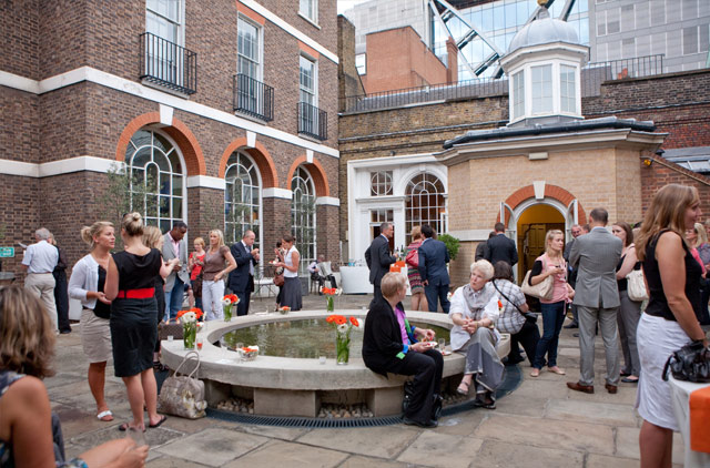 Skinners Hall London Venue Hire EC4, guests mingling outside with a fountain