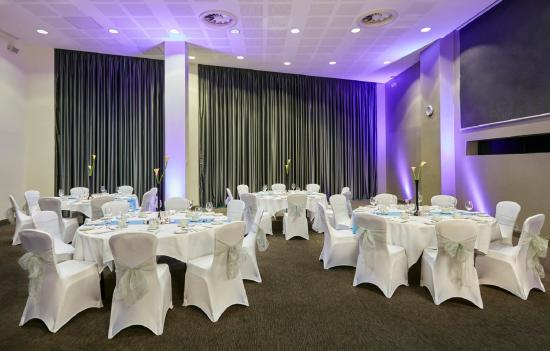 Round tables dressed for a wedding in the Smithfield Suite Crowne Plaza Manchester Christmas Party M4