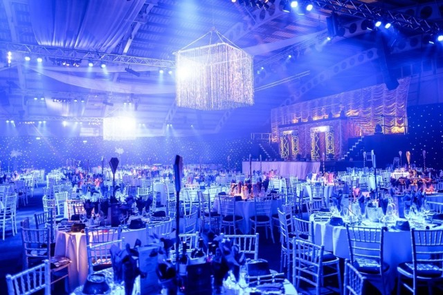 ICC Birmingham Christmas Party B1, stunning theming, seated dinner set up, large stage