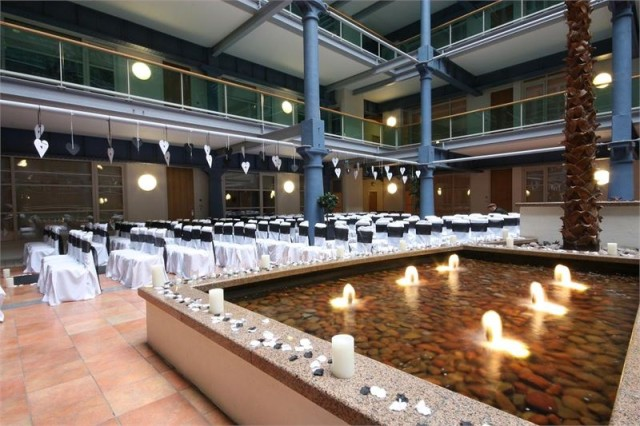 View of a wedding ceremony in the Atrium The Place Aparthotel Venue Hire M1
