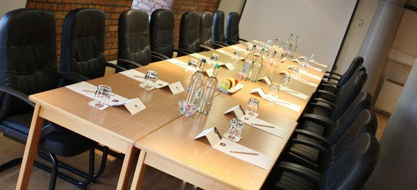 Heritage Rooms set up for a boardroom meeting The Place Aparthotel Venue Hire M1