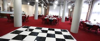 Place Aparthotel Christmas Party M1, Pennine Suite set up for a dinner dance with a dance floor and round tables