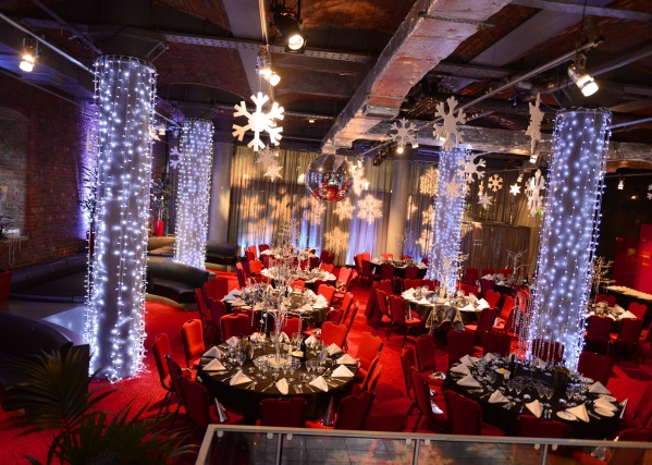 Place Aparthotel Christmas Party M1, Pennine Suite set up for a Christmas party with light around the pillars