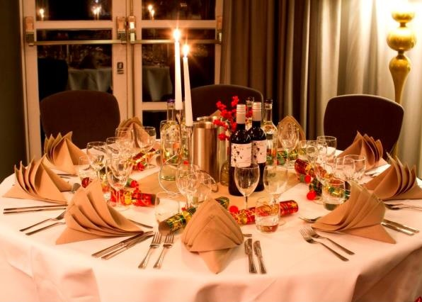 Crowne Plaza Kensington Christmas SW7, festive table set up, crackers and festive novelties