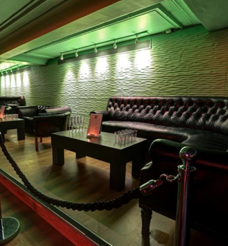 Qube Project Venue Hire SW1, VIP seating area, large sofas, roped off