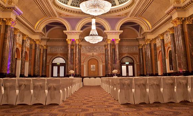 Gibson Hall Venue Hire EC2, stunning theatre layout with uplighters, high ceilings and collumns
