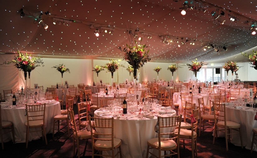 Conservatory at Painshill Venue Hire KT11, stunning centre pieces, ceiling lighting, largeround tables for dinner