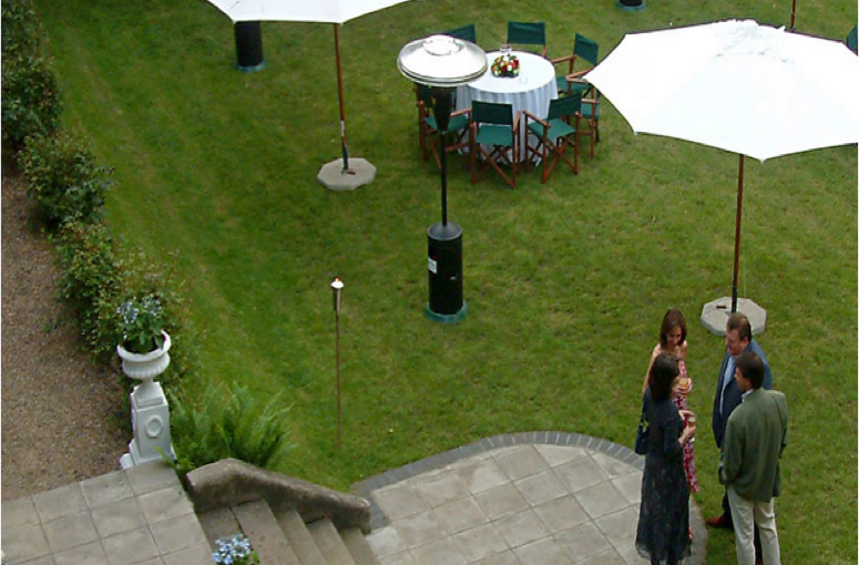 Winchester House Summer Party SW15, View from above of a lush green lawn with white giant umbrellas dotted around