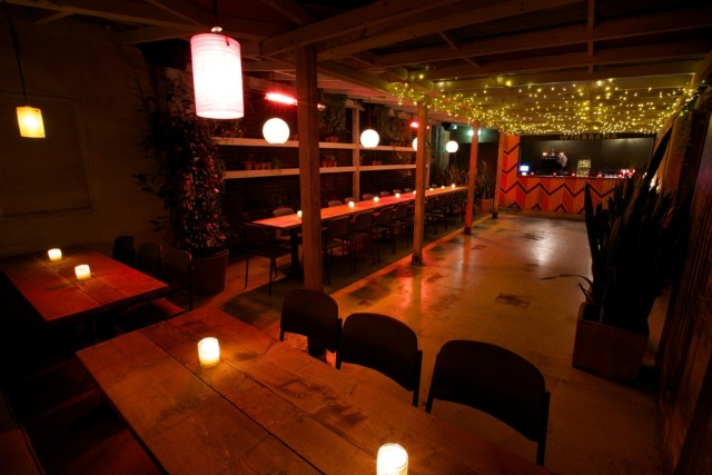 Winerama Room with tables and chairs around the edge decorated with candles at the Dinerama Christmas Party EC2