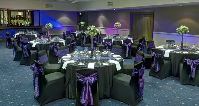 Hilton Aberdeen Treetops Christmas Party AB1, black table clothes with purple ribbons