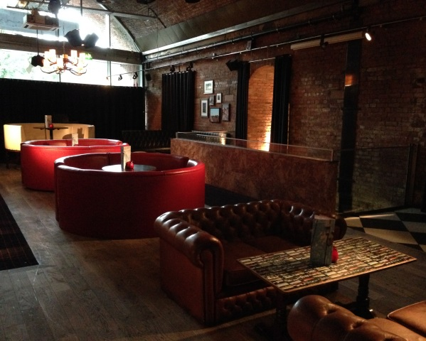 View of the main bar seating area with booths ARK Manchester Venue Hire M1