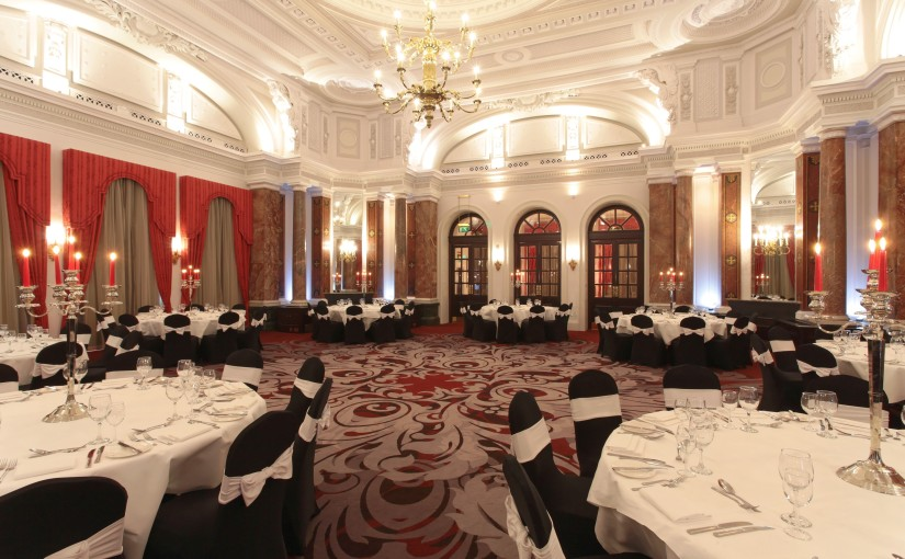 Round tables dressed in white linen for dinner Ballroom Amba Hotel Venue Hire WC2