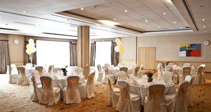 Hilton Bath Venue Hire BA1, venue set up for private dinner with cream furniture