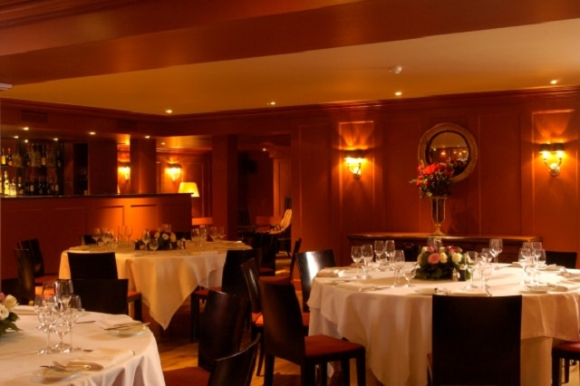 Bentley's Bar Grill Venue Hire W1. room set out for diner. warm, contempoary feel with dim lighting.