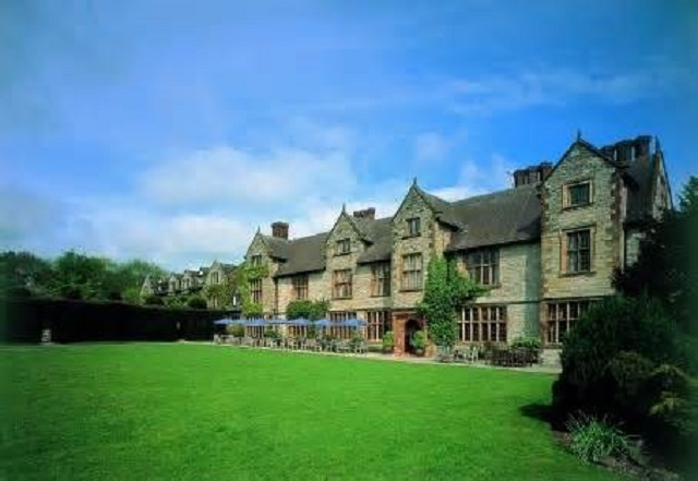 Billesley Manor Hotel Venue Hire B49. Picture of outside historic building with greenery surrounding.