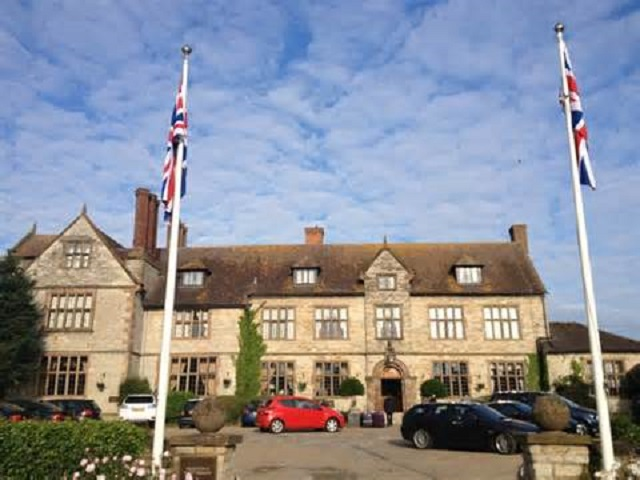 Billesley Manor Hotel Venue Hire B49. outside of historic building with car park and cars parked infront of venue