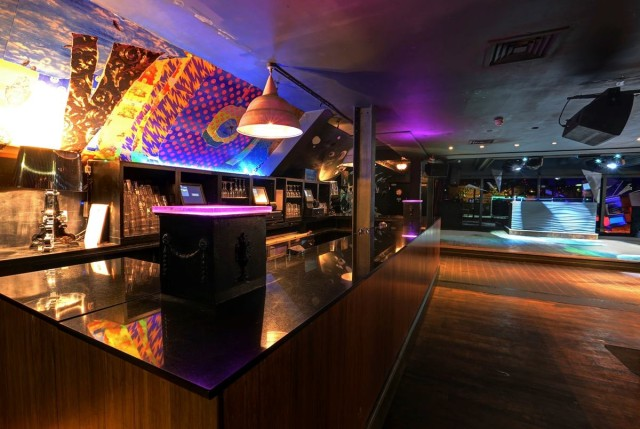 Qube Project Venue Hire SW1, large wooden floor area, booth seating