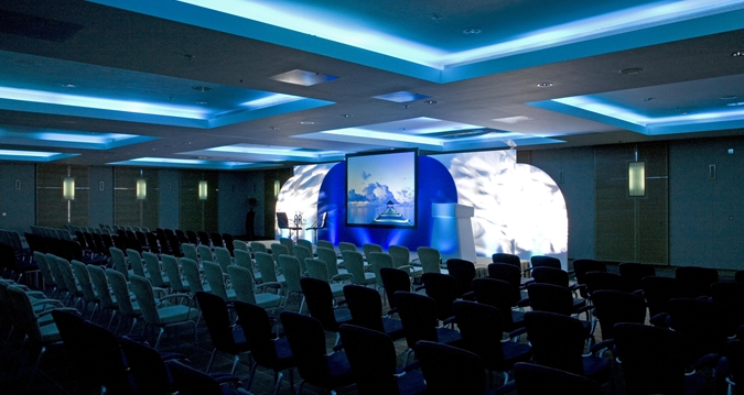 Hilton Canary Wharf Venue Hire E14,, large room set up conference style with blue lighting