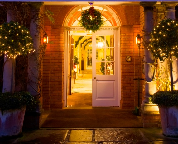 Chewton Glen Hotel Christmas Party BH2, door way lit up for Christmas with holly and mistle toe