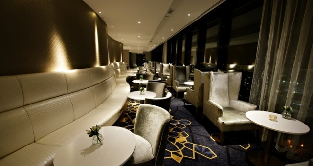 Eros Lounge with sofa seating and floor to ceiling views of manchster Cloud 23 Venue Hire M3