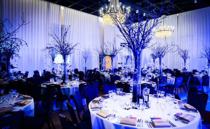 Glaziers Hall Christmas Party SE1, large round tables, draping, chandeliers and centre pieces