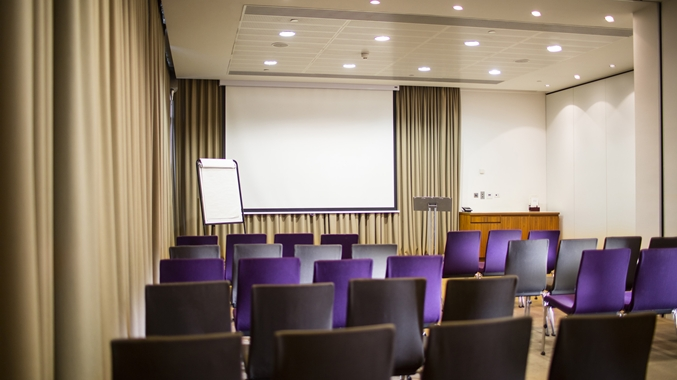Doubltree By Hilton Leeds Venue Hire LS1, conference set up with purple chair
