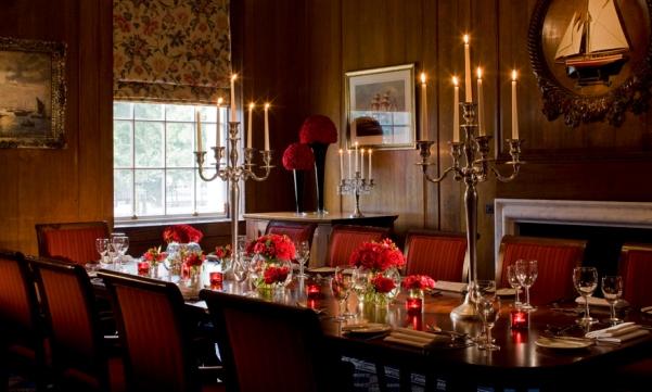 Devonport House Christmas Party SE10, festive banqueting set up, candelarbas, flower centre pieces