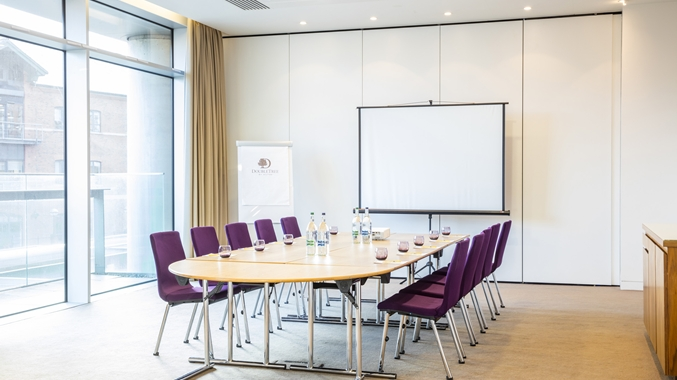 Doubltree By Hilton Leeds Venue Hire LS1, board room set up with purple chairs