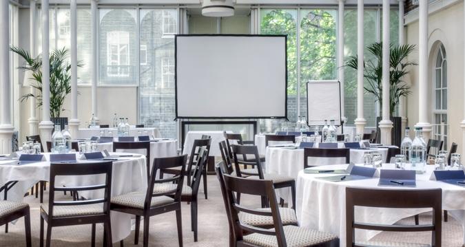 Hilton London Euston Venue Hire WC1, cabaret set up in a glass room