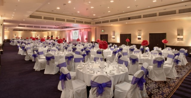 Tower Suite set for dinner with round tables and white linen for a gala dinner Bridge Suites Tower Hotel Venue Hire E1