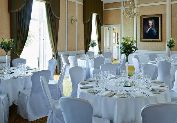 Dalmahoy Hotel and Country Club Venue Hire EH27, seated dinner set up, large round tables, centre pieces, natural daylight